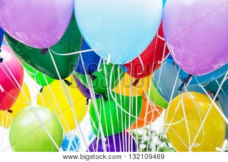 Balloons party. Colorful balloons background. Leisure activity. Funny symbolic objects. Vibrant colors.