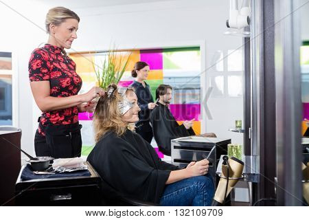 Woman Getting Her Hair Dyed In Salon