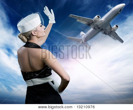 Sexy stewardess and flying plane