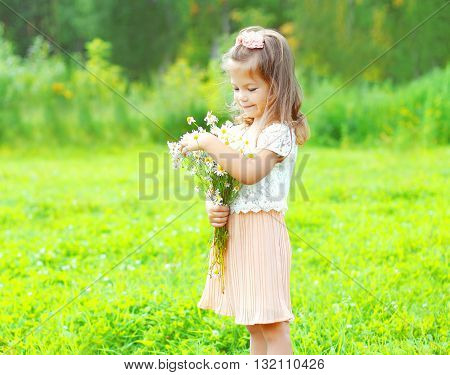 Cute Little Girl Child With Bouquet Chamomiles Flowers In Summer Day