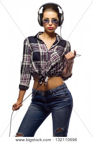 Young girl in jeans listen music isolated