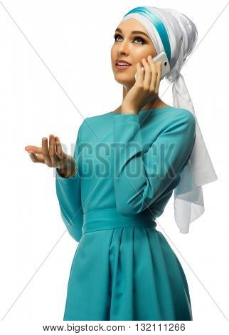 Muslim young woman with mobile phone isolated