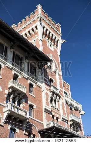 Old building with tower near Sant'Ambrogio in Milan (Lombardy Italy)