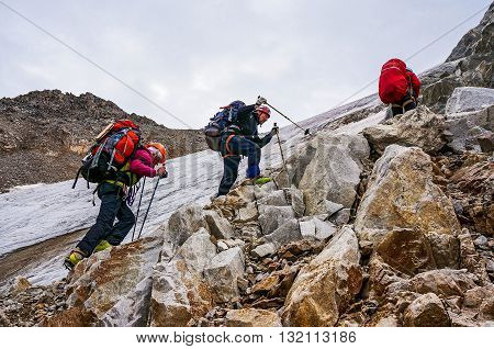 CAUCASUS KABARDINO-BALKARIA RUSSIA - JULY 25 2014: Group of climbers ascend to the mountain during a sporting hike