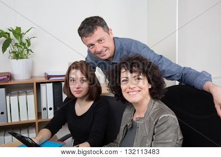 Group Of People In Business Meeting Working Together