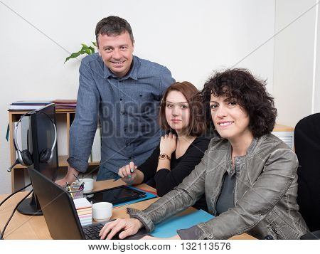 Smiling Business Team At Office Working Together