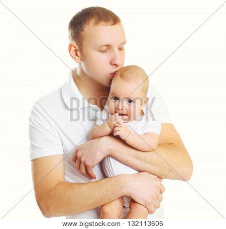 Loving Father Hugging And Kissing Baby On White Background
