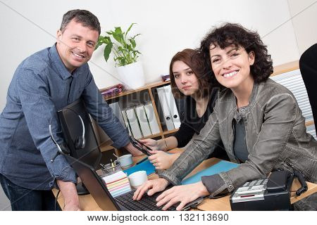 Smiling And Happy Business Team At Work