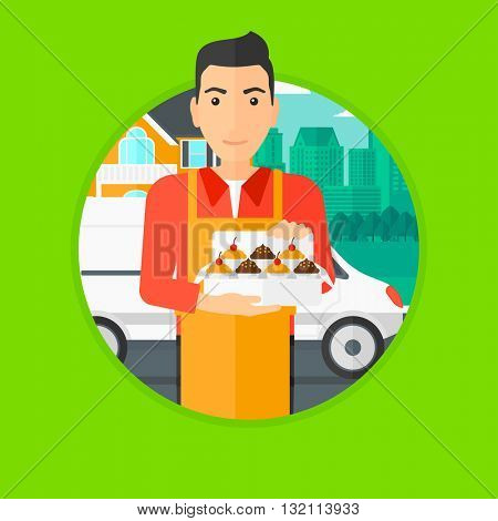 A baker holding a box of cakes. A baker delivering cakes. A baker with cupcakes standing on the background of delivery truck. Vector flat design illustration in the circle isolated on background.