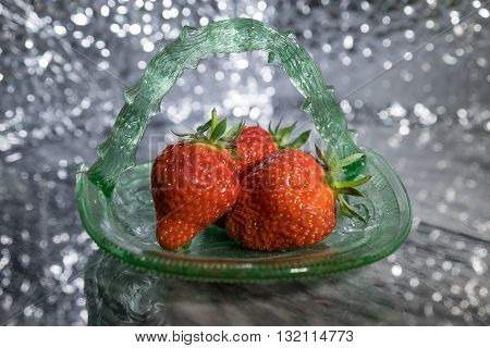 Strawberries In Old Green Glass Dish With Sparkly Backdrop