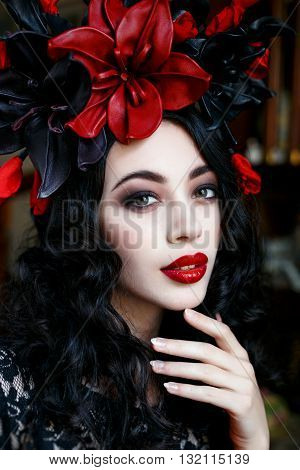 Portrait of a beautiful young woman in a wreath on had. beauty girl with red lips. Female face with clear skin close-up. Skincare