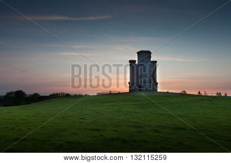 Sunset at Paxton's Tower Perched on a hilltop near Llanarthney in the Towy Valley, a folly designed by the Samuel Pepys Cockerell and built by Sir William Paxton.