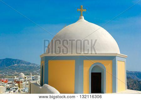 Church in Fira, modern capital of the Greek Aegean island, Santorini, in the sunny day, Greece