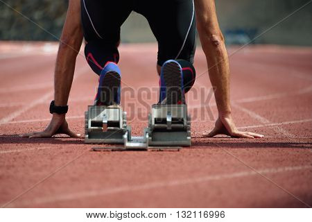 Sprint start in track and field view from behind