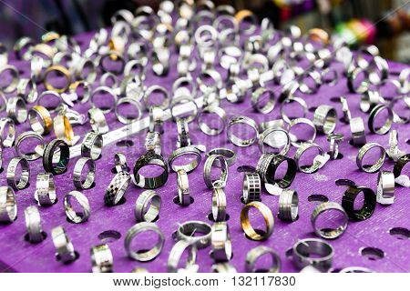 Display With Different Designs Of Handmade Silver Rings On Pinkstand
