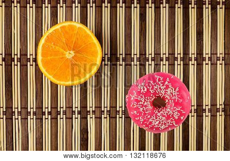 Donuts In Pink Frosting And Orange Fruit