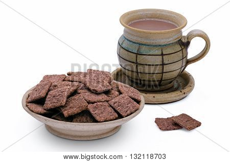Red rice crackers and cup of chocolate milk on white background