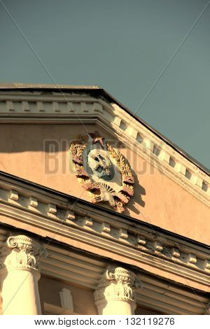 Emblem of USSR on the building. Part of the roof