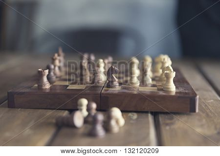 Pawn And Chessboard Game On Wooden Table, Vintage Tone And Selected Focus