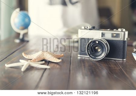 Globe, Camera, Map, And Starfish Figurine For Use As Trip Vacation Concept (vintage Tone And Selecte