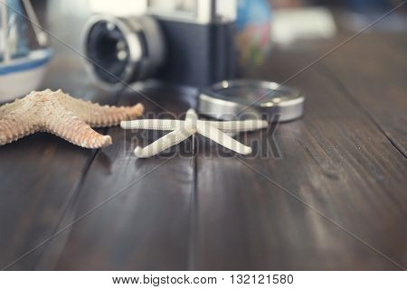 Camera, Compass, Globe, Ship And Starfish Figurine For Use As Trip Vacation Concept (vintage Tone An
