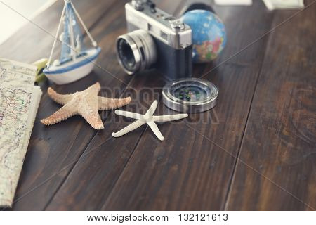Compass, Camera, Globe,map, Car, Ship And Starfish Figurine For Use As Trip Vacation Concept (vintag