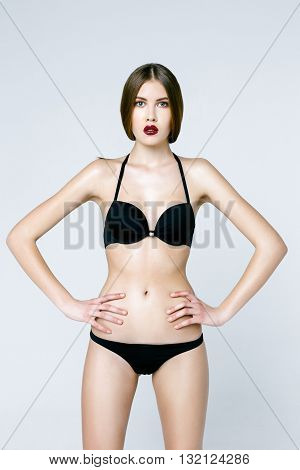sexy woman in black underwear on white isolated