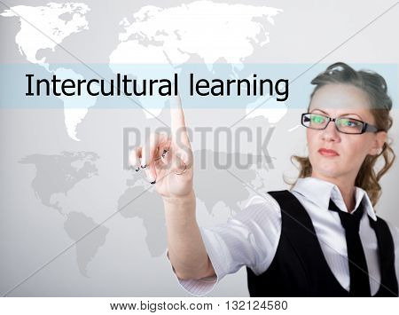 Intercultural learning written in search bar on virtual screen. technology, internet and networking concept. Internet technologies in business and home. woman in business suit and tie, presses a finger on a virtual screen.