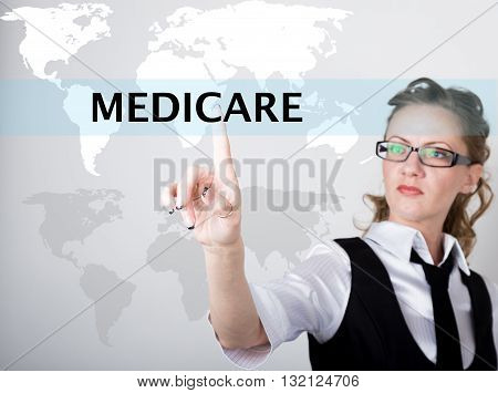 Medicare written in search bar on virtual screen. technology, internet and networking concept. Internet technologies in business and home. woman in business suit and tie, presses a finger on a virtual screen.