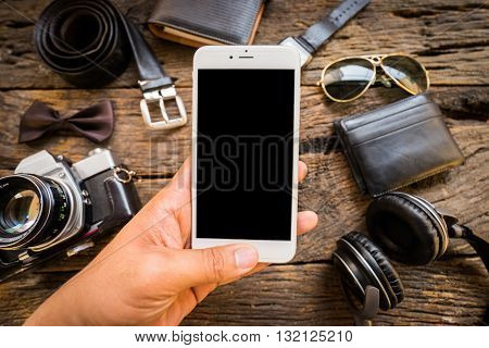 Men's Casual  Old Camera,mobile Phone And Supplies On Office Wooden Table.