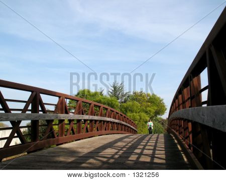 Woman Walking On Rusty Bridge