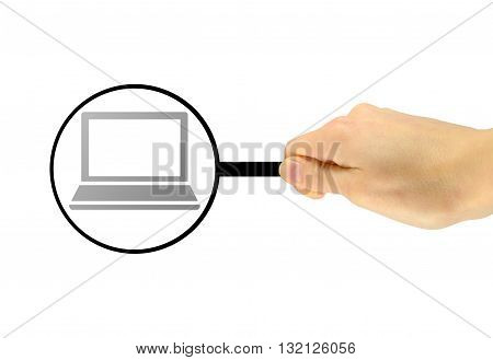 Man's Hand With A Magnifying Glass Examines Computer