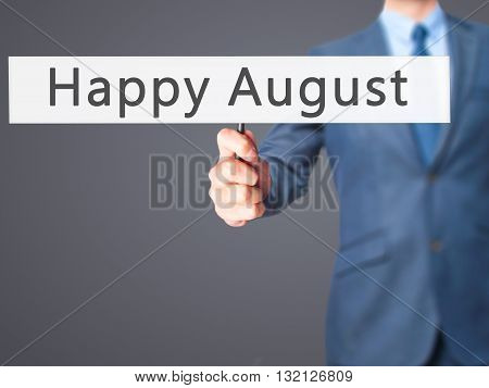 Happy August - Businessman Hand Holding Sign