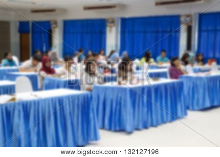 blur blurred abstract at Business education training conference hall or room seminar meeting People Analyzing Statistics Financial Concept with attendee background