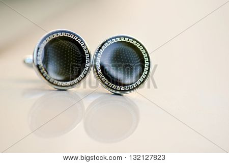 Cufflinks with black stone and reflection in natural light