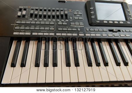 Music workstation synthesizer with digital display and side light