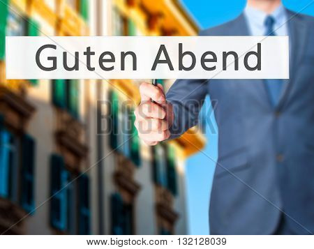 Guten Abend (good Evening In German) - Businessman Hand Holding Sign
