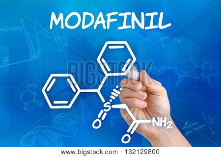 Hand With Pen Drawing The Chemical Formula Of Modafinil