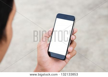 man holding phone white screen outdoor lifestyle