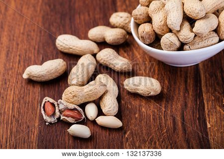 Peanuts isolated on a wooden table