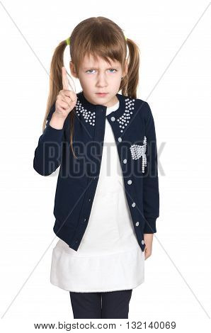 A very serious little girl. Threatens her finger