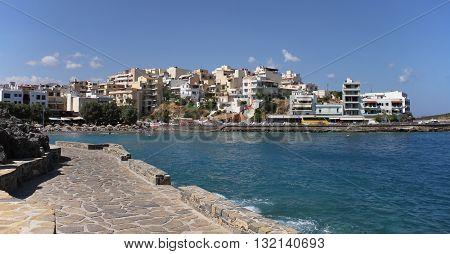 Eastern Bay Beach, Agios Nikolaos, Crete, Greece  / View of Beautiful Bay Beach and Buildings in Agios Nikolas