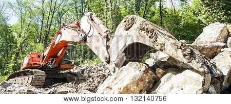 Excavator with big shovel to work with rocks
