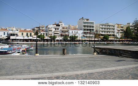 View to Agios Nikolaos Over Lake Voulismeni, Crete, Greece / Lake Voulismeni with Fishing Boats at Agios Nikolaos