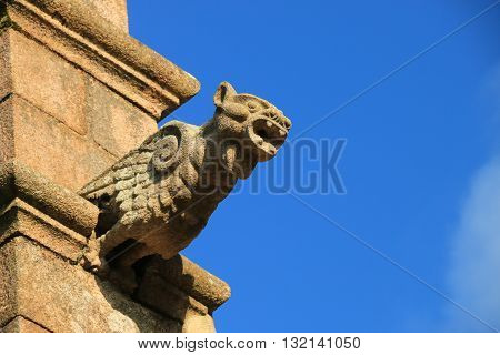 A gargoyle on the facade of breton church , côtes d Armor , Brittany, France