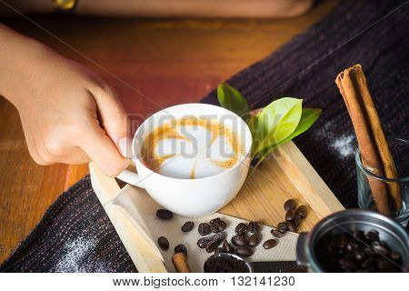 Creative Work With A Cup Of Boiling Water In His Hands. A Handful Of Coffee, Green, Ground And Solub