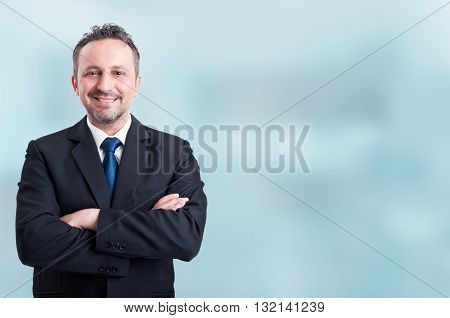 Confident Businessman Smiling And Holding Arms Crossed