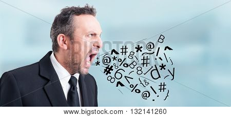 Angry irritated businessman screaming and shouting out loud with symbols and letters coming out of his mouth as insulting concept