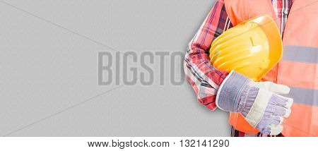 Picture Of Professional Builder In Workwear With Yellow Helmet