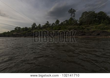 Mekong River Showing Water Currants And Tidal Flow  With Dramatic Sky Showing Boarder With Thailand